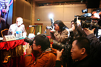CHINA. Beijing. Press photographers photograph snooker players at a press conference. Press attention is huge and players are constantly photographed by the media. . Snooker is a cue sport played on a large table measuring 3.6 metres x 1.8 metres. Originating in India in the late 19th Century where it was invented by British Army officers, the game has been a mainstay in British sport over the past few decades. Recently however, popularity of the sport has declined as the sport struggles to compete with other popular sports. The sport is however flourishing in countries such as China, where it is now the second most popular sport, behind Basketball. In a country where the  players are treated like movie-stars, China may be the great hope for the sports recovery. 2009