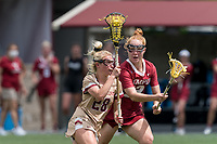 NEWTON, MA - MAY 16: Hollie Schleicher #28 of Boston College on the attack during NCAA Division I Women's Lacrosse Tournament second round game between Temple University and Boston College at Newton Campus Lacrosse Field on May 16, 2021 in Newton, Massachusetts.
