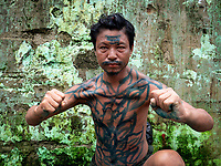 Perhaps a crazy man...displaying his fake body tattoos along the river bank at the Yangon River, Yangon, Myanmar, Burma