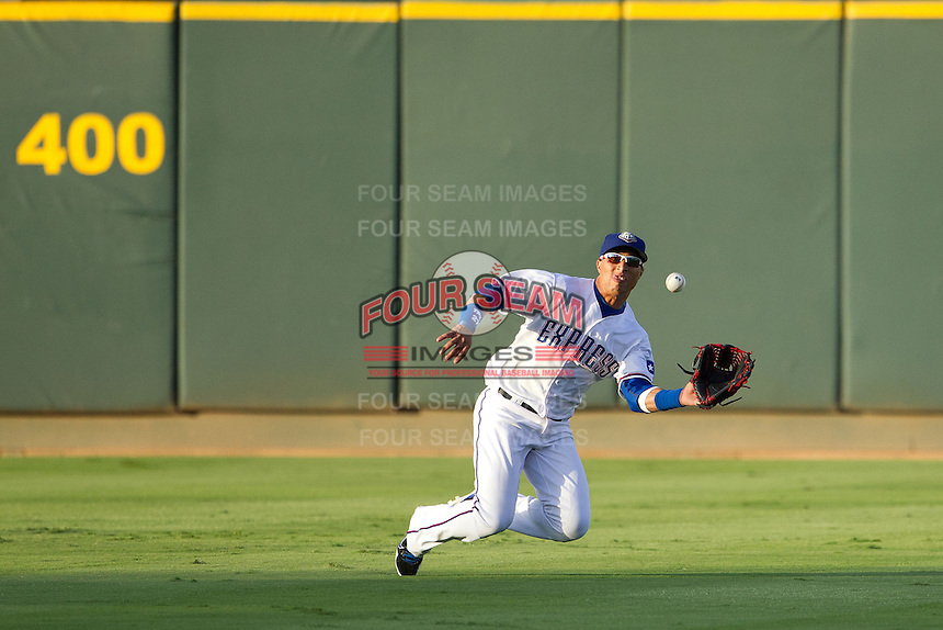 Round Rock Express outfielder Leonys Martin #27 makes a diving catch during the Pacific Coast League baseball game against the Nashville Sounds on August 26th, 2012 at the Dell Diamond in Round Rock, Texas. The Sounds defeated the Express 11-5. (Andrew Woolley/Four Seam Images)...