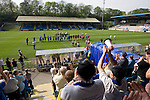 FC Halifax Town 1 Mickleover Sports 1, 23/04/2011. The Shay, Northern Premier League. Supporters in the east stand applauding the teams onto the pitch at The Shay, home of FC Halifax Town (in blue), on the day that they were presented with the Northern Premier League Premier Division championship trophy following their match with Mickleover Sports, which ended in a 1-1 draw in front of a crowd of 2,404. The club replaced Halifax Town A.F.C. who went into administration during the 2007–08 season, having previously been members of the Football League for 80 years. Their promotion meant they would play in Conference North in the 2011-12 season. Photo by Colin McPherson.