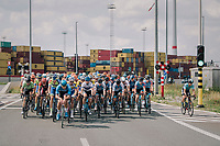 "peloton racing through the Port of Antwerp<br /> <br /> Antwerp Port Epic 2018 (formerly ""Schaal Sels"")<br /> One Day Race:  Antwerp > Antwerp (207 km; of which 32km are cobbles & 30km is gravel/off-road!)"