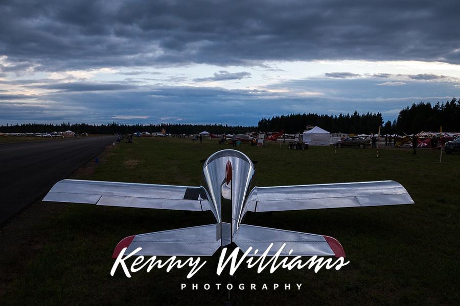 Reflective silver aircraft at dusk, Arlington Fly-In 2016, WA, USA.