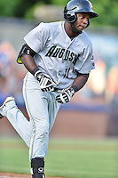 Augusta GreenJackets left fielder Jean Angomas (11) runs to first base during a game against the Asheville Tourists at McCormick Field on August 5, 2016 in Asheville, North Carolina. The Tourists defeated the GreenJackets 7-6. (Tony Farlow/Four Seam Images)