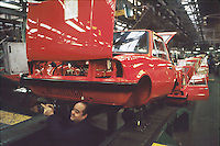 - assembly lines in the car factory Innocenti Leyland at Milan Lambrate (1979)....- catene di montaggio nella fabbrica di automobili Innocenti  Leyland a Milano Lambrate (1979)
