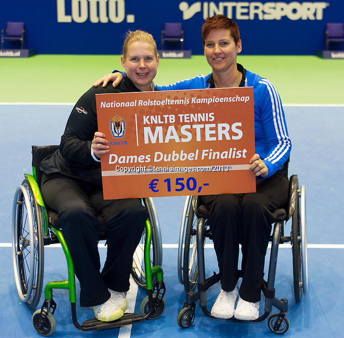21-12-13,Netherlands, Rotterdam,  Topsportcentrum, Tennis Masters, Final doubles lady's wheelchair: runners up Michaela Spaanstra(L( and Mieke van Chastelet(NED)<br /> Photo: Henk Koster