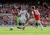 Pictured L-R: Leon Britton of Swansea passing the ball while being marked by Aaron Ramsey of Arsenal. Saturday 10 September 2011<br /> Re: Premiership Arsenal v Swansea City FC at the Emirates Stadium, London.