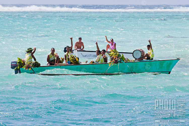 Polynesians celebrating the end of a sailboat race at the finish line