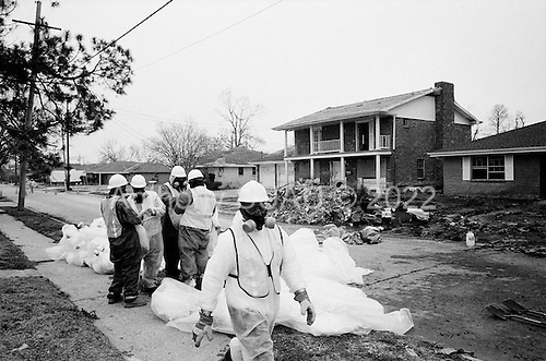 New Orleans, Louisiana.USA.February 21, 2006..An independent contractor under the Army Corps of Engineers work to clean up asbestus taken from roof tops in damaged areas. The homes were damaged when the levees broke in New Orleans and flooded 75% of the city after hurricane Katrina in August 2005........