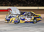 Martin Truex Jr., driver of the (56) NAPA Auto Parts Toyota, gets towed in after wrecking his car during the Samsung Mobile 500 Sprint Cup race at Texas Motor Speedway in Fort Worth,Texas.