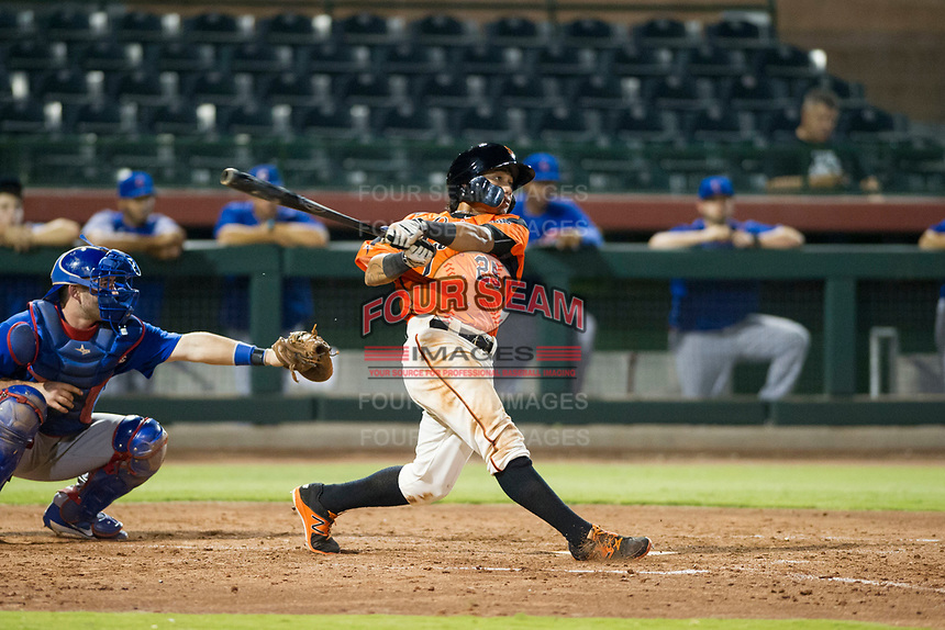 AZL Giants center fielder Ismael Munguia (29) follows through on his swing against the AZL Cubs on September 5, 2017 at Scottsdale Stadium in Scottsdale, Arizona. AZL Cubs defeated the AZL Giants 10-4 to take a 1-0 lead in the Arizona League Championship Series. (Zachary Lucy/Four Seam Images)