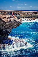 Woman and surging billows, Washington Slagbaai National Park, Supladó, Bonaire, Netherland Antilles, Caribbean Sea, Atlantic Ocean, MR