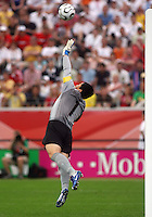 Korea Republic's goalkeeper Woon Jae Lee turns away a shot. Korea Republic defeated Togo 2-1 in their FIFA World Cup Group G match at the FIFA World Cup Stadium, Frankfurt, Germany, June 13, 2006.