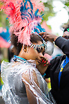 © Joel Goodman - 07973 332324 . 12/08/2017 . Manchester , UK . Carnival parade performers tweak their costumes . The annual Caribbean Carnival J'Ouvert Parade through Moss Side in South Manchester . The 2017 theme is Bacchanal . There is concern in the community following the stabbing to death of Sait Mboob during a mass fight which saw several seriously hurt on Tuesday night (8th August 2017) . Photo credit : Joel Goodman