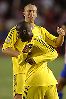 September 3, 2005 Photo by Matt A. Brown/ISI.Columbus Crew (13) Mark Schulte pats teammate (26) Cornell Glen after getting the assist on a score against Chivas USA in the second half.