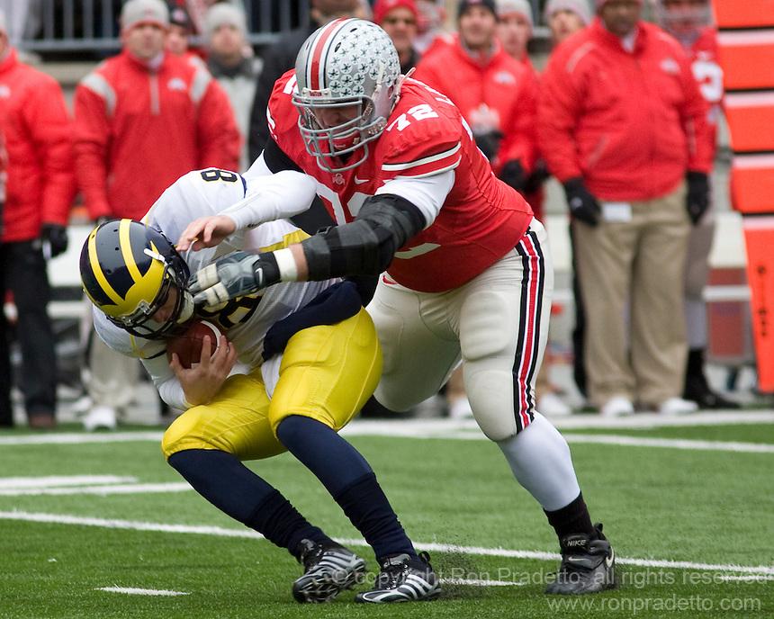 November 22, 2008. Ohio State defensive lineman Dexter Larimore sacks Michigan quarterback Nick Sheridan. The Ohio State Buckeyes defeated the Michigan Wolverines 42-7 on November 22, 2008 at Ohio Stadium, Columbus, Ohio.