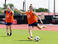 HOUSTON, TX - JUNE 12: Kristie Mewis #22 of the USWNT crosses the ball during a training session at University of Houston on June 12, 2021 in Houston, Texas.