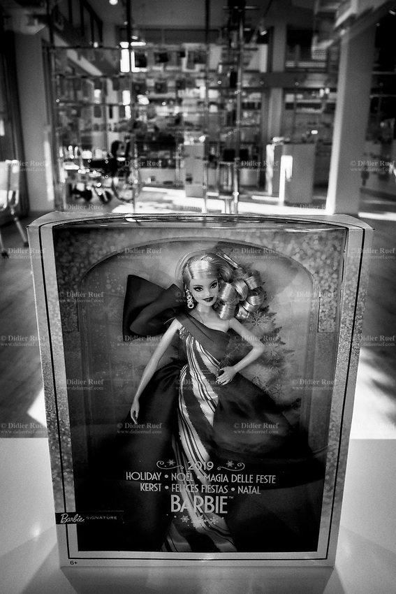 Switzerland. Canton Ticino. Lugano. City center. Pharmacy window. Barbie doll. Barbie is a fashion doll manufactured by the American toy company Mattel, Inc. and launched in March 1959. Barbie has been an important part of the toy fashion doll market for over fifty years. Mattel has sold over a billion Barbie dolls, making it the company's largest and most profitable line. The doll transformed the toy business in affluent communities worldwide by becoming a vehicle for the sale of related merchandise (accessories, clothes, friends of Barbie, etc.). She had a significant impact on social values by conveying characteristics of female independence, and with her multitude of accessories, an idealized upscale life-style that can be shared with affluent friends. 2.01.2020  © 2020 Didier Ruef