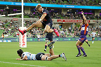 19th March 2021; Melbourne Rectangular Stadium, Melbourne, Victoria, Australia; Australian Super Rugby, Melbourne Rebels versus New South Wales Waratahs; Tom Pincus of the Rebels leaps over Jeremy Williams of the Waratahs as he scores a try