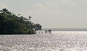 Pará State, Brazil. The Amazon River. People on a rickety pier.