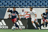 FOXBOROUGH, MA - AUGUST 7: Damian Rivera #72 of New England Revolution II looks to pass as Owen Guske #50 of Orlando City B defends during a game between Orlando City B and New England Revolution II at Gillette Stadium on August 7, 2020 in Foxborough, Massachusetts.