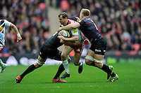 Nick Evans of Harlequins is tackled by Alistair Hargreaves and Jackson Wray of Saracens