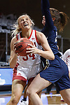 SIOUX FALLS, SD - MARCH 6: Hannah Sjerven #34 of the South Dakota Coyotes gets past Regan Schumacher #20 of the Oral Roberts Golden Eagles during the Summit League Basketball Tournament at the Sanford Pentagon in Sioux Falls, SD. (Photo by Richard Carlson/Inertia)
