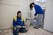 Painting and decorating NVQ trainees at a college run by Barnsley Community Build, a social enterprise, South Yorkshire.