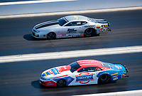Nov 3, 2019; Las Vegas, NV, USA; NHRA pro stock driver Alex Laughlin (near) against Chris McGaha during the Dodge Nationals at The Strip at Las Vegas Motor Speedway. Mandatory Credit: Mark J. Rebilas-USA TODAY Sports