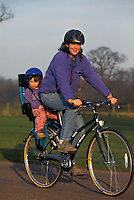 Debbie and Hannah riding bicycle with child seat . Windsor .pic copyright Steve Behr / Stockfile
