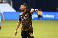 KANSAS CITY, UNITED STATES - AUGUST 25: Christian Ramirez #13 of Houston Dynamo shouts out instructions  a game between Houston Dynamo and Sporting Kansas City at Children's Mercy Park on August 25, 2020 in Kansas City, Kansas.