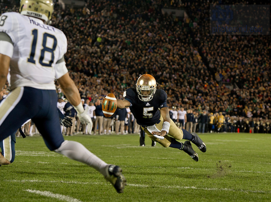 Nov. 3, 2012; Quarterback Everett Golson dives into the end zone to tie the game in a two-point conversion against Pttisburgh in the fourth quarter. Photo by Barbara Johnston/University of Notre Dame