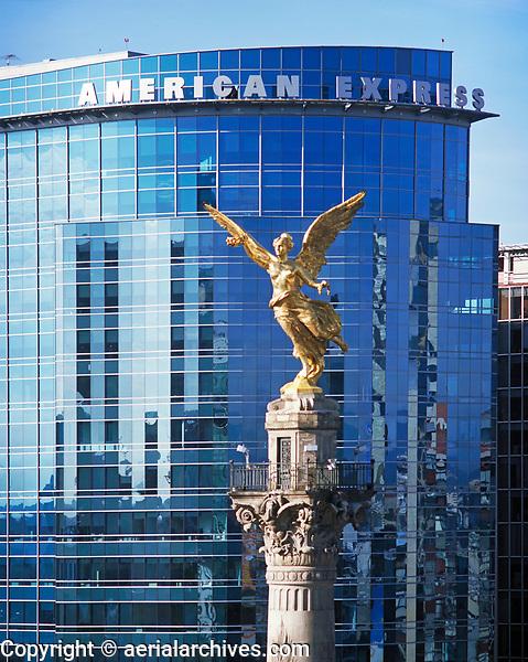 aerial photograph of the El Angel Independence monument at the La Reforma avenue in Mexico City with the American Express building in the background | fotografía aérea del monumento a la Independencia de El Ángel en la avenida La Reforma en la Ciudad de México con el edificio de American Express
