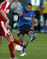Dwayne DeRosario takes a shot during MLS Cup 2003.  The San Jose Earthquakes defeated the Chicago Fire 4-2 in the MLS Championship at The Home Depot Center on November 23, 2003.