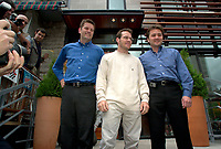 Montreal, June 5th 2001<br /> <br /> BAR team Formula One driver, JACQUES VILLENEUVE pose with business partners Jean-Pierre Da Costa Li and Martin Poitras in front of their new restaurant - dance club ``Newtown `` on Crescent Street in downtown, June 5th 2001 MONTREAL , Canada.<br /> Photo by Pierre Roussel
