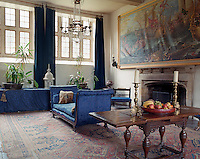A large gilt-framed painting depicting a sea battle dominates this reception room