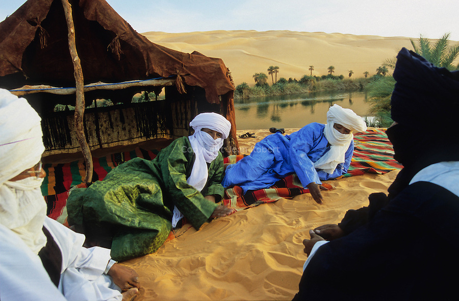 Bivouac on the banks of the Oum el Ma lake (the mother of water in Arabic). A night-blue gem set in a green and gold jewelcase of palmtrees and sand.
