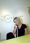.Reception staff answers phone.Photo Alan Edwards