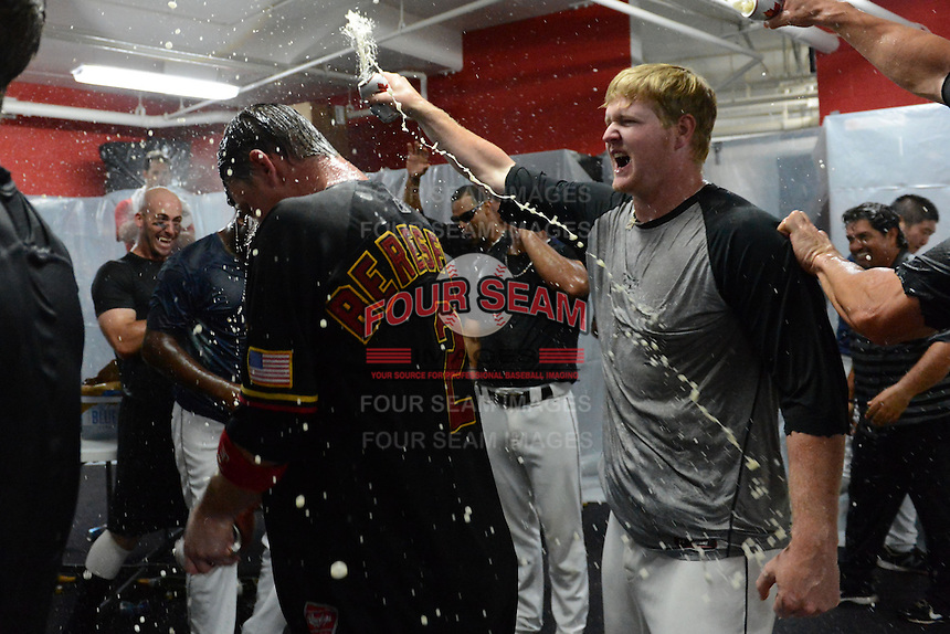 Rochester Red Wings infielder James Beresford (2) and pitcher Logan Darnell celebrate in the locker room after defeating the Scranton Wilkes Barre RailRiders on September 2, 2013 at Frontier Field in Rochester, New York to clinch the International League Wild Card Playoff spot.  (Mike Janes/Four Seam Images)