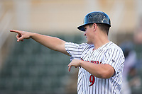 Kannapolis Intimidators manager Justin Jirschele (9) points out the defensive alignment while coaching third base during the game against the Hagerstown Suns at Kannapolis Intimidators Stadium on June 14, 2017 in Kannapolis, North Carolina.  The Intimidators defeated the Suns 10-1 in game two of a double-header.  (Brian Westerholt/Four Seam Images)