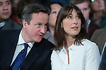 © Joel Goodman - 07973 332324 . 28/03/2015 . Manchester , UK . David Cameron shares a joke with wife Samantha Cameron , sitting ahead of the Prime Minister's speech , at the Conservative Party Spring Forum at the Old Granada Studios , Quay Street , Manchester . Photo credit : Joel Goodman