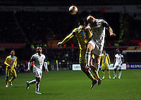 Swansea, UK. Thursday 20 February 2014<br /> Pictured: Jonjo Shelvey of Swansea (R) wins a header against Marek Hamsik (17) of Napoli<br /> Re: UEFA Europa League, Swansea City FC v SSC Napoli at the Liberty Stadium, south Wales, UK