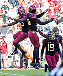 Florida State defensive back Hamsah Nasirildeen, left, and defensive end Brian Burns celebrate Nasirildeen's interception of a Boston College pass in the first quarter of an NCAA college football game in Tallahassee, Fla., Saturday, Nov. 17, 2018. (AP Photo/Mark Wallheiser)