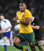 Australia's Tevita Kuridrani, centre, makes abreak against New Zealand in the Bledisloe Cup rugby match, Forsyth Barr Stadium, Dunedin, New Zealand, Saturday, October 19, 2013. Credit:SNPA / Dianne Manson.