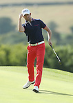 Frenchman Gregory Bourdy punches the air to celebrate his birdie putt on the 17th in the final round of the ISPS Handa Wales Open 2013 at the Celtic Manor Resort.<br /> <br /> 01.09.13<br /> <br /> ©Steve Pope-Sportingwales