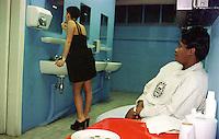 GERMANY, Hamburgs, african woman work in public toilet / DEUTSCHLAND  , Hamburg, Afrikanerin arbeitet als Toilettenfrau