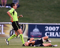Sonia Bompastor #8 of the Washington Freedom in agony on the ground as referee Jose Carlos Rivero prepares the issue a red card to Alex Scott #22 of the Boston Breakers for the tackle during a WPS match at Maryland Soccerplex on July 29, in Boyds, Maryland. Freedom won 1-0.