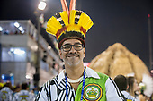 Imperatriz Leopolinense Samba School, Carnival, Rio de Janeiro, Brazil, 26th February 2017. Carnavalesco Cahé Rodrigues smiling during the parade, wearing an indigenous feather headdress.