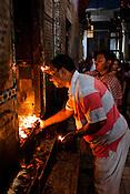 Hindu Pilgrims visit and offer prayers at the Gauri Kedareshwar temple  on Kedar Ghat in the ancient city of Varanasi in Uttar Pradesh, India. Photograph: Sanjit Das/Panos