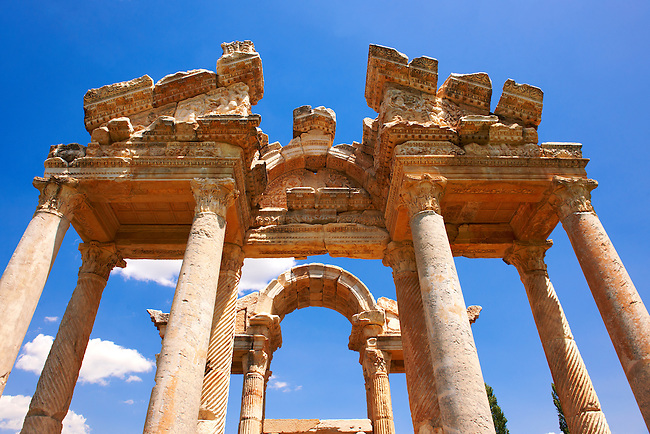 """Picture of the double Tetrapylon Gate, Aphrodisias, Turkey. A tetrapylon (Greek: Τετράπυλον, """"four gates"""") is an ancient type of Roman monument of cubic shape, with a gate on each of the four sides: generally it was built on a crossroads. stock photos & photo art prints. 8"""